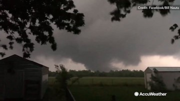 Tornado swirls ominously near neighborhood