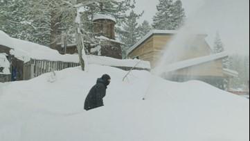 Heavy snow buries empty ski resort