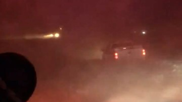 Vehicle stranded in midst of chaotic, blizzardlike conditions