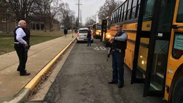Police say teen suspect died at Indiana middle school after firing at officers