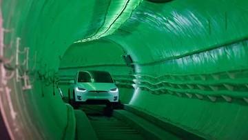 Elon Musk unveils underground tunnel, offers rides to VIPs