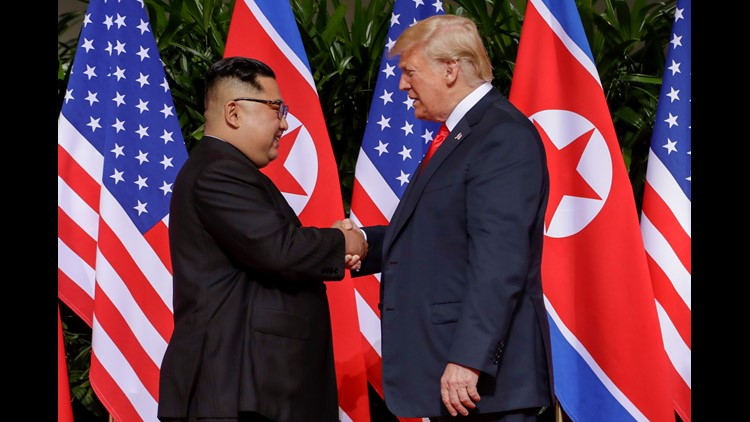 President Trump shakes hands with North Korea leader Kim Jong Un at the Capella resort on Sentosa Island in Singapore.