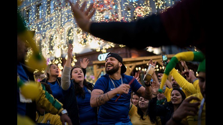 Soccer fans from Brazil dance as they gather on Nikolskaya Street ahead of the 2018 soccer World Cup in Moscow, Russia. Fans from participating countries gathered in the central pedestrian street to chant, wave flags, and meet fans from around the world.