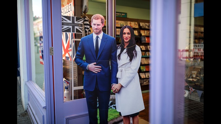 A cardboard cut-out display of Prince Harry and Meghan Markle sits outside a card shop in Windsor a few weeks before their wedding on May 19, 2018.