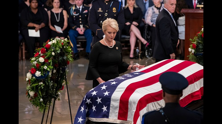 After a week of bipartisan tribute, McCain is laid to rest