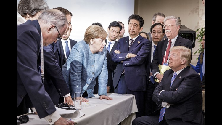 In this photo provided by the German Government Press Office, German Chancellor Angela Merkel deliberates with President Trump on the sidelines of the official agenda on the second day of the G7 summit on June 9, 2018 in Charlevoix, Canada.