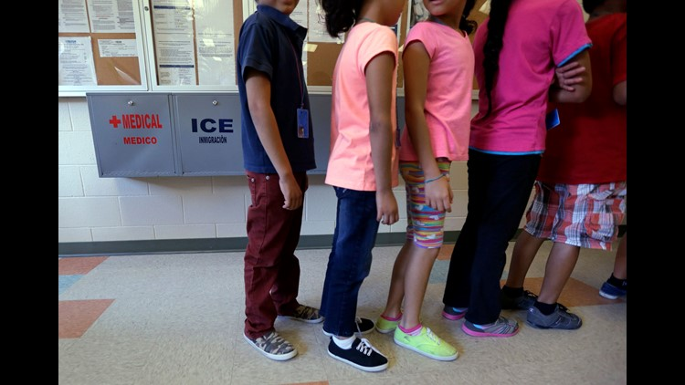 In this 2014 file photo, detained immigrant children line up in the cafeteria at the Karnes County Residential Center, a temporary home for immigrant women and children detained at the border in Karnes City, Texas.