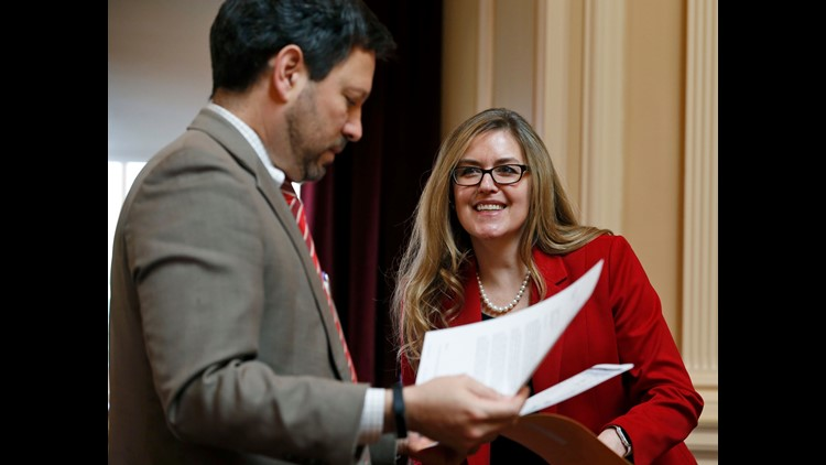 In this Wednesday, April 11, 2018 photo, Virginia State Sen. Jennifer Wexton, D-Loudon, center, talks with Sen. Scott Surovell, D-Fairfax, left, during the Senate special budget session at the Capitol in Richmond, Va. Wexton is one of the candidates in th