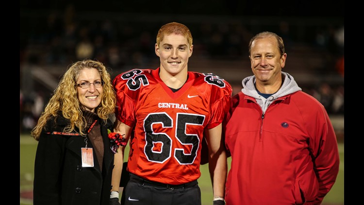 Timothy Piazza with his parents, Evelyn and James.