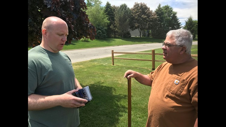 Caleb Frostman (left), the Democratic candidate in Tuesday's special election for state Senate, talks to Sturgeon Bay voter Tom Fernandez.