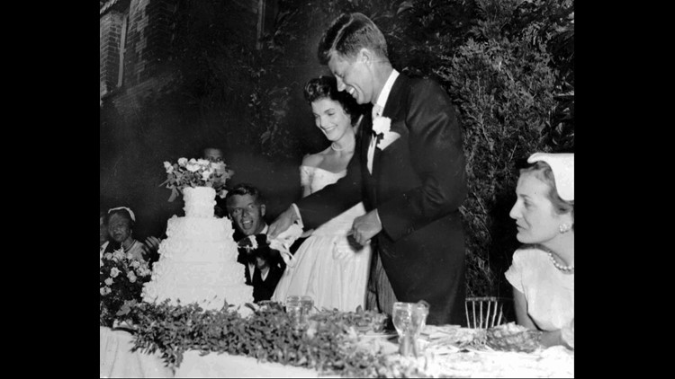 Then-U.S. Senator John F. Kennedy and his bride, the former Jacqueline Lee Bouvier, cut their wedding cake following their marriage Sept. 12, 1953 in Newport, R.I.