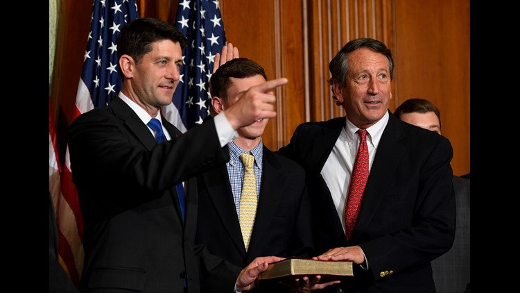 Rep. Mark Sanford, R-S.C., stands with House Speaker Paul Ryan, R-Wisconsin, for a ceremonial swearing-in and photo-op during the opening session of the 115th Congress, Tuesday, Jan. 3, 2017, on Capitol Hill in Washington.