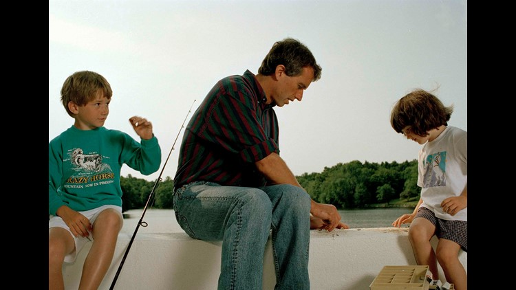 Robert Kennedy fishes with his son Bobby Jr., 8, left, and daughter Kathleen, near Mount Kisco, New York.