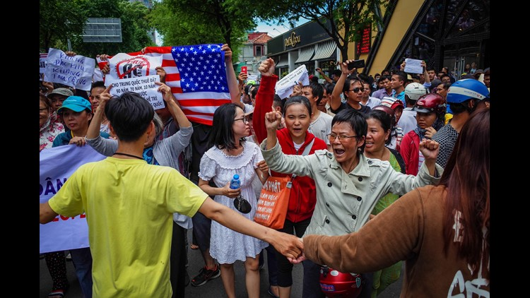 Vietnamese protesters shout slogans against a proposal to grant companies lengthy land leases during a demonstration in Ho Chi Minh City on June 10, 2018. The draft law at the centre of the furore would allow 99-year concessions in planned special economi