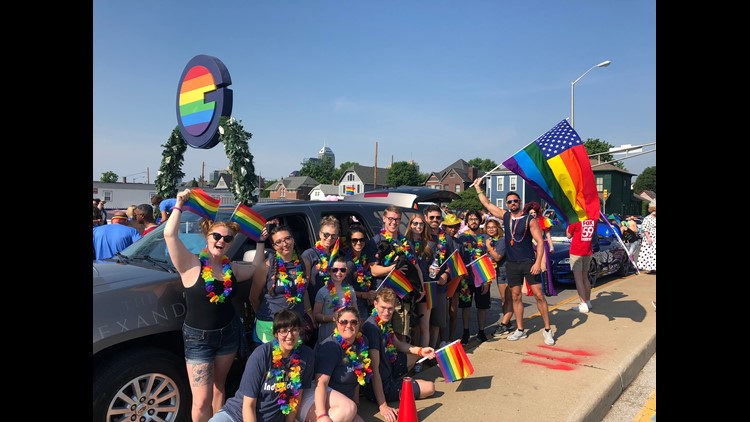 """Employees from The Alexander, a Dolce Hotel, marched in the  Indianapolis Pride Festival June 8 alongside the """"Alexander-mobile"""" and team puppy, Calvin, offering giveaways and beads to the guests."""