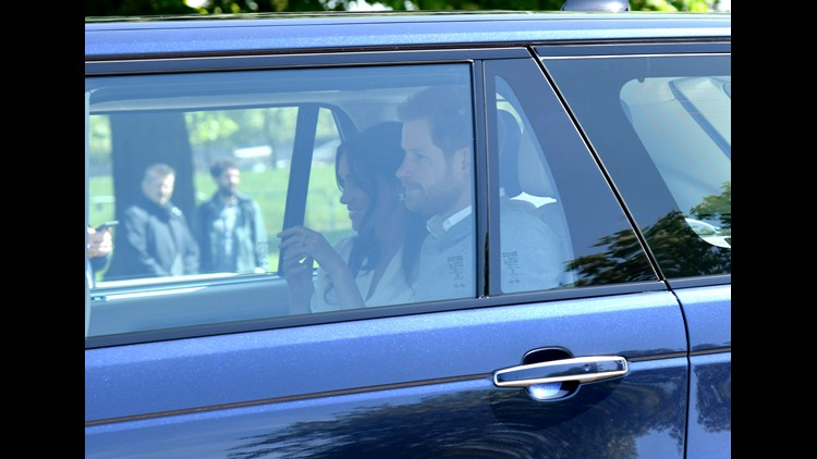 Prince Harry and Meghan Markle arrive in Windsor Thursday for their wedding rehearsal. William, Kate and the queen were also seen in the convoy of Range Rovers.