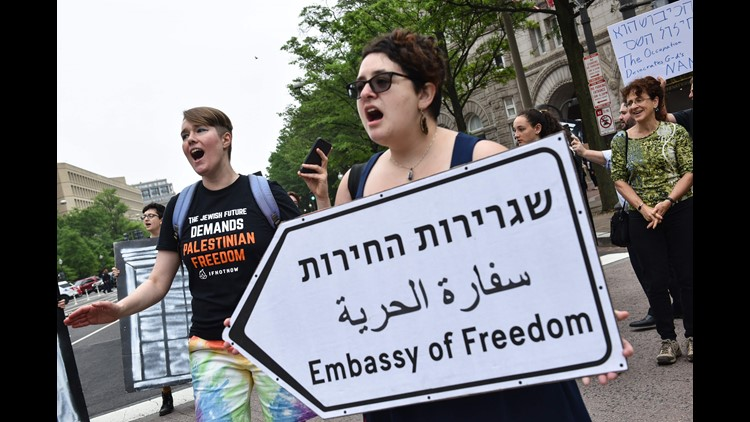 Demonstrators take part in a protest outside of the Trump International Hotel in Washington, DC, against the opening of the U.S. Embassy in Jerusalem on May 14, 2018.
