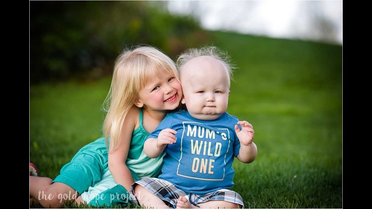 When cancer hits one member of the family, it impacts everyone, said mom Terrie Erickson. Here brother and sister, Finnleigh and Declan Erickson, charm the Gold Hope Project photographer.