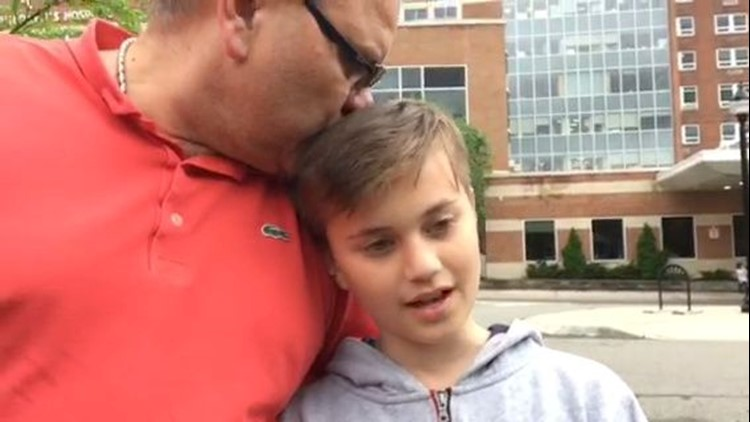 Theo Ancevski, 11, was in the bus from East Brook Middle School that crashed. He escaped through an emergency exit. His father, Pavle, is with him.