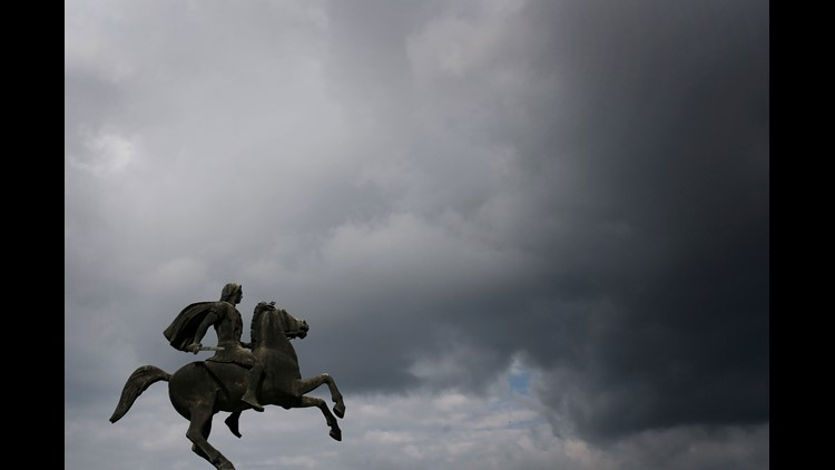 In this Oct, 8, 2014 file photo, a modern bronze statue of Alexander the Great stands under the cloudy sky of the northern port city of Thessaloniki, Greece.