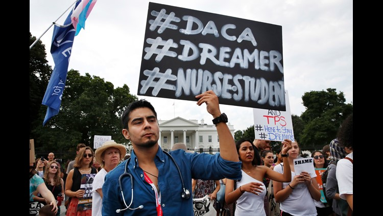 Nursing student Carlos Esteban, a DACA recipient,  rallies outside the White House on Sept. 5, 2017.