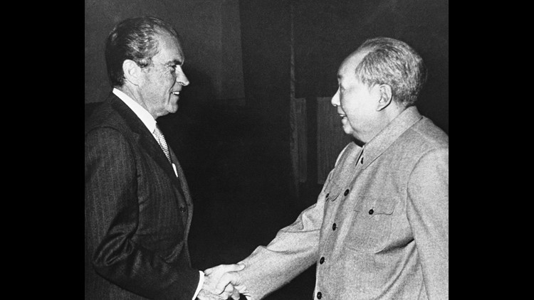 In this Feb. 5, 1972 file photo, U.S. President Richard Nixon shakes hands with Communist leader Mao Tze-tung during Nixon's historic trip to Communist China.