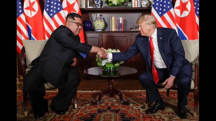 President Trump shakes hands with North Korea leader Kim Jong Un during their first meetings at the Capella resort on Sentosa Island in Singapore.