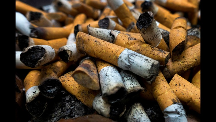 Smoked cigarettes are seen in an ashtray in Centreville, Virginia. Just 13.9 percent of the U.S. population smokes cigarettes, according to a U.S. government report.