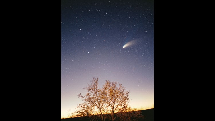 As comets, like Hale Bopp shown here, pass near the sun, they release dust that can reach Earth's orbit and settle through the atmosphere where it can be collected.
