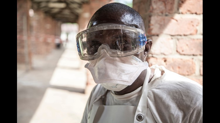 A handout photo made available by UNICEF shows a health worker outside the isolation ward at Bikoro Hospital, where suspected Ebola patients are diagnosed and treated, in Bikoro, The Democratic Republic Of The Congo, May 12, 2018.