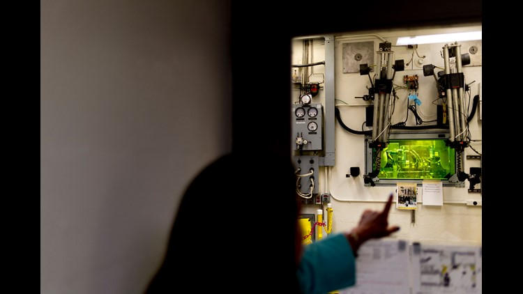 Cf-252 Program Manager Julie Ezold points out a lab at the Radiochemical Engineering Development Center at Oak Ridge National Laboratory in Oak Ridge, Tennessee on Wednesday, May 16, 2018. The REDC is a multipurpose radiochemical processing and research f
