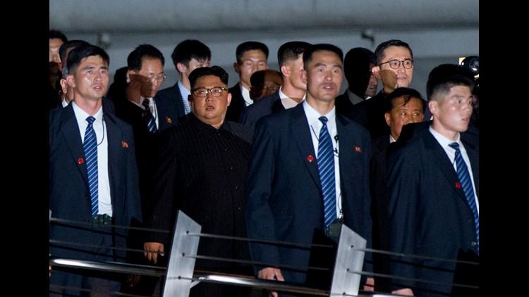 North Korean leader Kim Jong Un, center, walks in Marina Bay, Singapore, June 11, 2018 ahead of the summit with  President Trump.