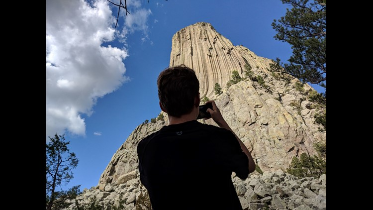 Aren Elliott takes a photo of Devils Tower. If you thought this rock was impressive in the movie, you should see it in person.