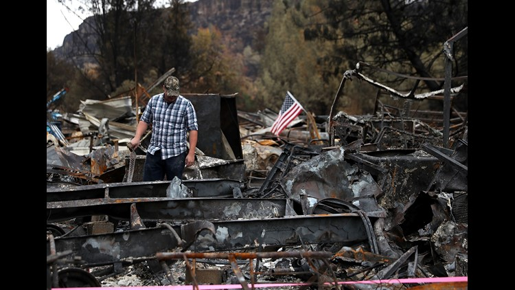Noah Fisher looks over his home that was destroyed by the Camp Fire on November 22, 2018 in Paradise, California. Fueled by high winds and low humidity the Camp Fire ripped through the town of Paradise charring over 150,000 acres, killed at least 85