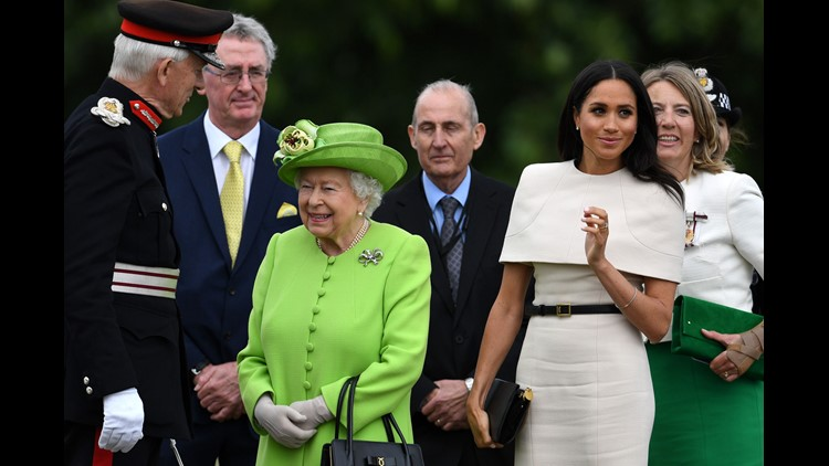 Queen Elizabeth II and Meghan, Duchess of Sussex arrive to open the new Mersey Gateway Bridge on June 14, 2018 in the town of Widnes in Halton, Cheshire, England.