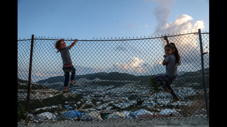 Children play on a fence inside a camp for forcibly displaced people in Khirbet al-Joz, Latakia, Syria, on May 31, 2018.