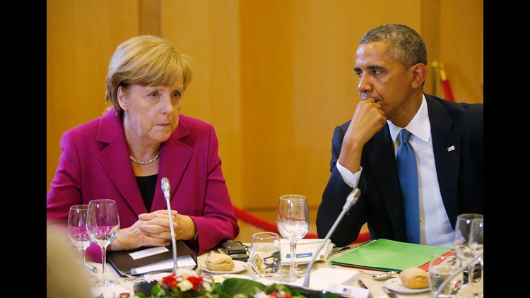 U.S. President Barack Obama, right, and German Chancellor Angela Merkel are seated together at a G7 working dinner in Brussels, Belgium, Wednesday, June 4, 2014.