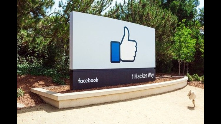 Sign with a big thumbs-up marking the entrance to Facebook's campus.