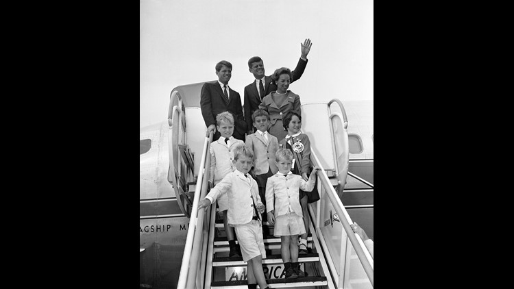Sen. John F. Kennedy?, Democratic presidential nominee in 1960, waves from plane ramp as he and members of his traveling party get set to board plane bound for Massachusetts. With him are his brother, Robert, left, and Robert's wife, John Kennedy's nephew