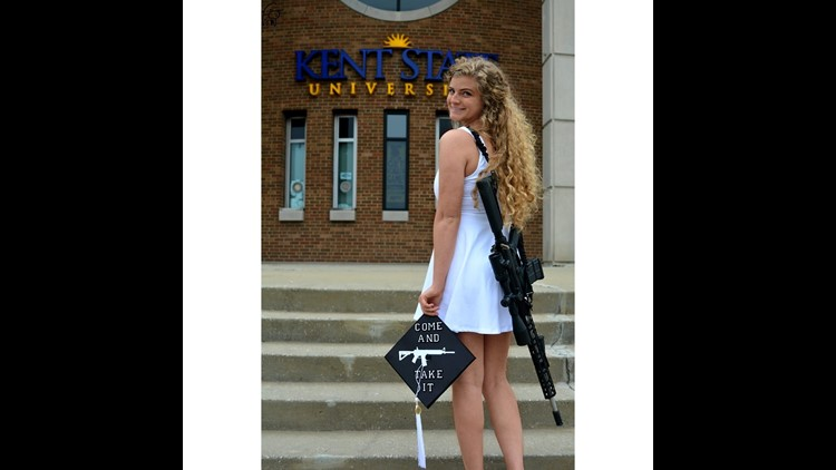 Photo of college graduate wearing AR-10 rifle goes viral