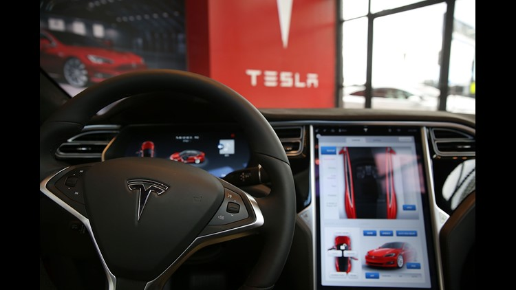 The inside of a Tesla vehicle is viewed as it sits parked in a new Tesla showroom and service center in Red Hook, Brooklyn on July 5, 2016 in New York City. The electric car company and its CEO and founder Elon Musk have come under increasing scrutiny fol