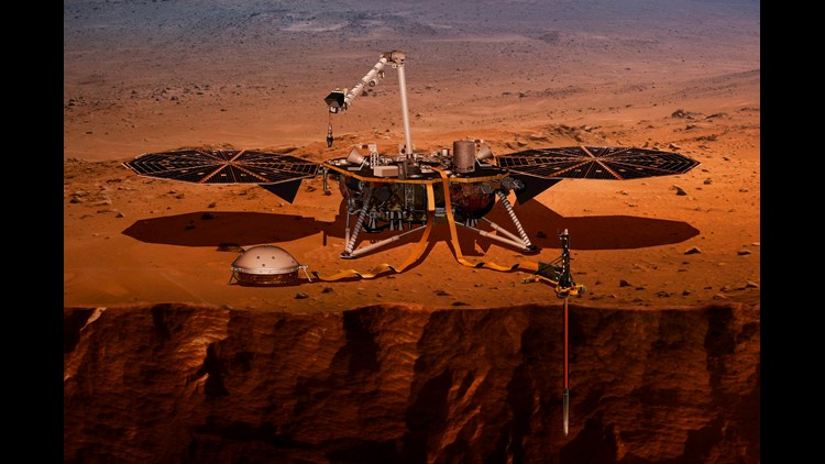 This illustration made available by NASA in 2018 shows the InSight lander drilling into Mars. InSight, short for Interior Exploration using Seismic Investigations, Geodesy and Heat Transport, is scheduled to launch from Vandenberg Air Force Base on May 5,