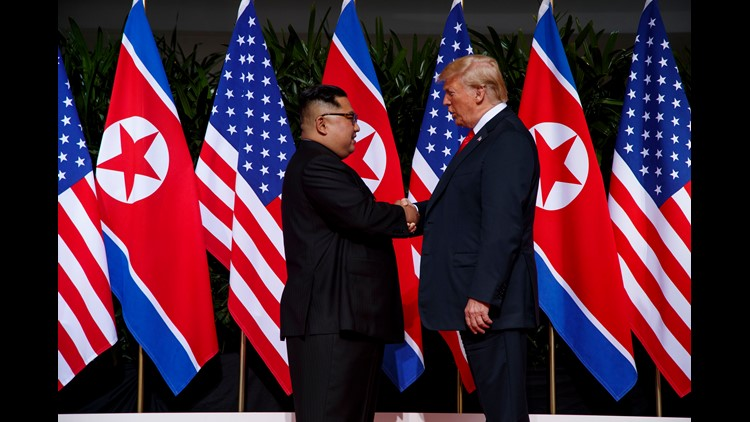 President Donald Trump meets with North Korean leader Kim Jong Un on Sentosa Island on June 12, 2018, in Singapore.
