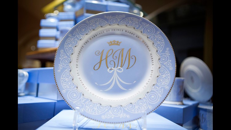 A plate with the initials H and M, part of the new official range of commemorative china to celebrate the May 19 wedding of Prince Harry and Meghan Markle, on display in shop at Buckingham Palace.