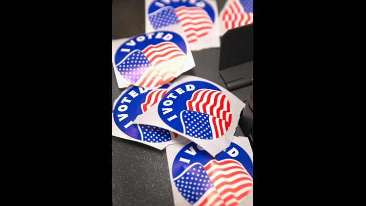 "A pile of ""I Voted"" stickers, which are handed out to residents after they vote, sit on a voting machine at a polling place on November 4, 2014 in Ferguson, Missouri.  President Obama has suggested that mandatory voting might help America with big-money e"