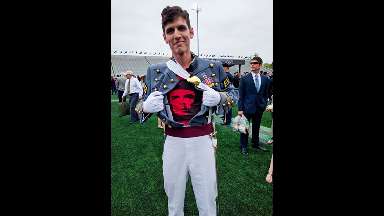In this May 2016 photo provided by Spenser Rapone, Rapone displays a shirt bearing the image of socialist icon Che Guevara under his uniform, after graduating from the United States Military Academy at West Point, N.Y. After Rapone, who was already a comb
