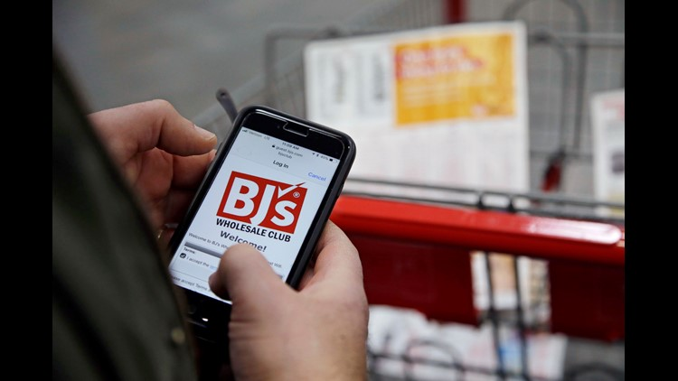 Tony D'Angelo logs into the stores Wi-Fi to download the BJ's Express Scan app on his cell phone before beginning his shopping at the BJ's Wholesale Club in Northborough, Mass. BJ's Wholesale Club is going public, again. BJ's has announced that it filed a
