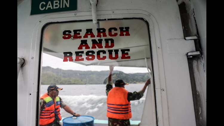 Members of an Indonesian search and rescue team looks for victims of a sunken ferry on Lake Toba in North Sumarta, Indonesia, June 19,  2018.
