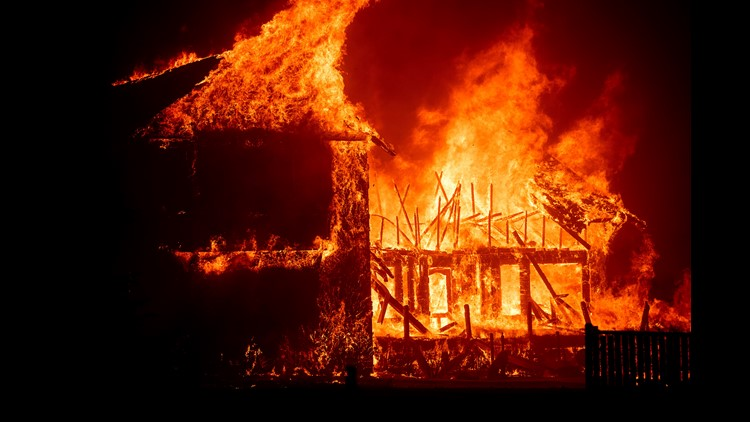 A home burns as the Camp Fire rages through Paradise, Calif., on Thursday, Nov. 8, 2018. Tens of thousands of people fled a fast-moving wildfire Thursday in Northern California, some clutching babies and pets as they abandoned vehicles and struck out on f