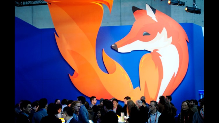 People gather in the Firefox booth at the Mobile World Congress, the world's largest mobile phone trade show in Barcelona, Spain, Thursday, Feb. 27, 2014. The global wireless show that wraps up on Thursday has seen a push to get mobile devices cheap enoug
